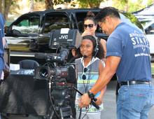 child with RiversideTV staff