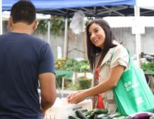 Resident using Go Green Reusable Bag