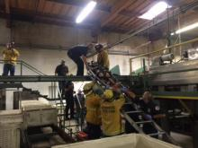 firefighters performing above ground rescue