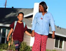 woman walking child to school