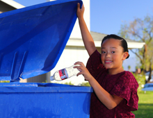 Child with recycle bin