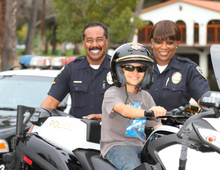 Riverside Police Department with Child on Motorcycle